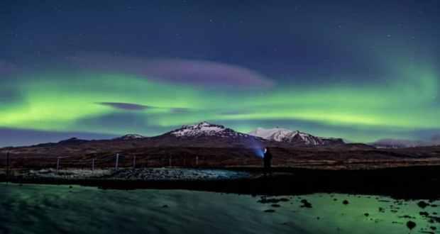 The Northern Lights aurora viewed across a mountain range