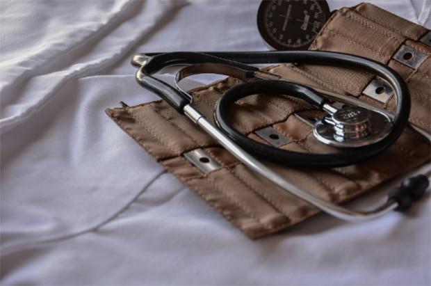 Doctors stethoscope on pressure arm strap