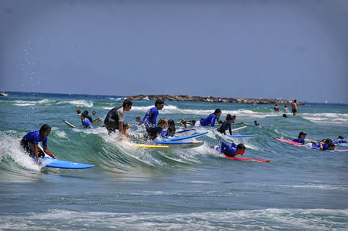Surfing in Tel Aviv by Flickr user werkunz1