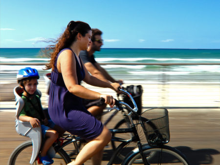 Biking along the Tel Aviv Tayelet (Promenade) by Flavio Grynszpan