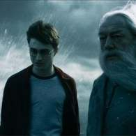 Daniel Radcliffe and Dumbledore Take a Wet Walk on the Beach