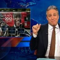 Jon Stewart Mourns the End of Herman Cain's Campaign: VIDEO