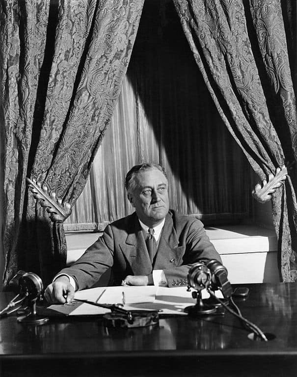 "Franklin D. Roosevelt broadcasts his first ""fireside chat"" from the White House in 1933. In 1932, he became the last Democratic candidate to be nominated in a contested convention. It was also the last year that Democrats required candidates to receive a two-thirds majority of convention delegates to receive the nomination, a rule implemented in the 1830s to hold the influence of southern Democrats invested in maintaining slavery. Starting in 1936, nominees needed only a simple majority of delegates to secure the nomination. Credit: National Archives and Records Administration/Wikimedia Commons"