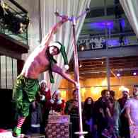 Santa's Buffest Pole Dancing Elf is Making Our Christmas Wishes Come True: WATCH