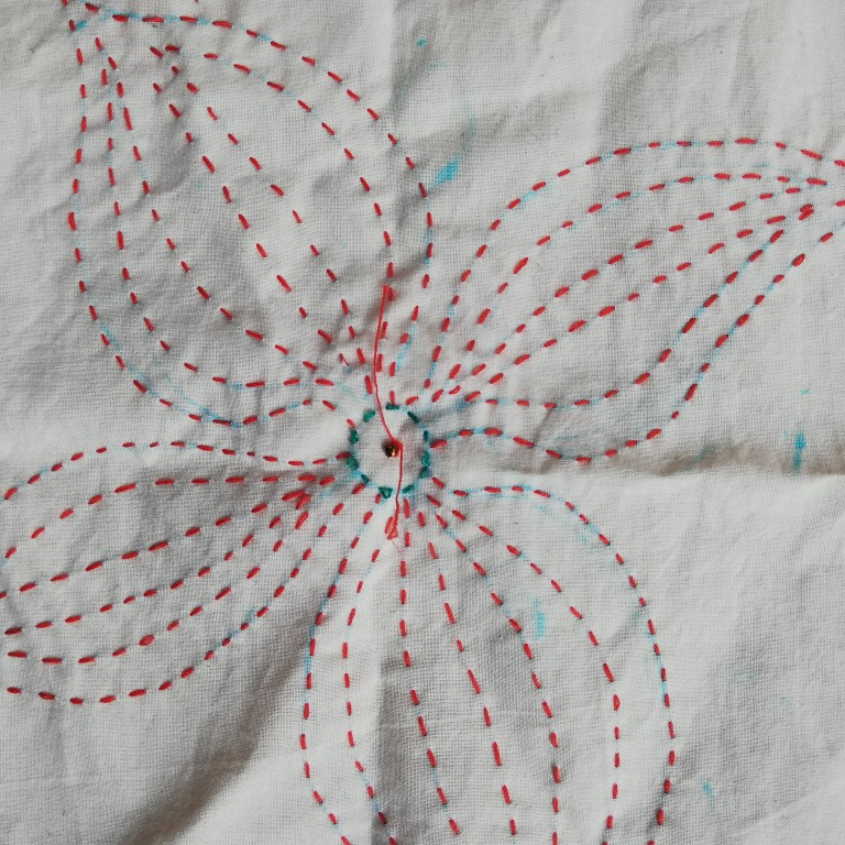 Bead sewn onto reverse of fabric