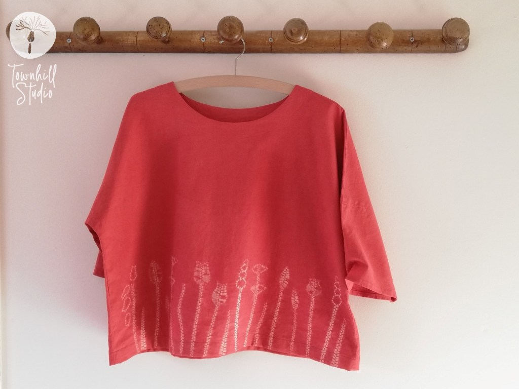 red dyed shift top
