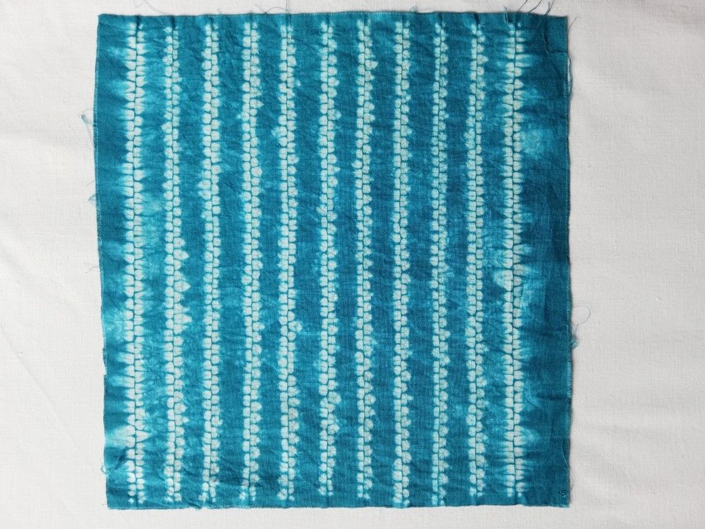 shibori patterned fabric with ori nui lines