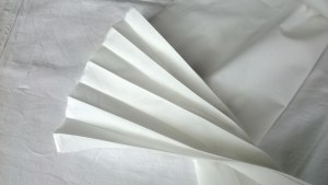 Concertina folded fabric