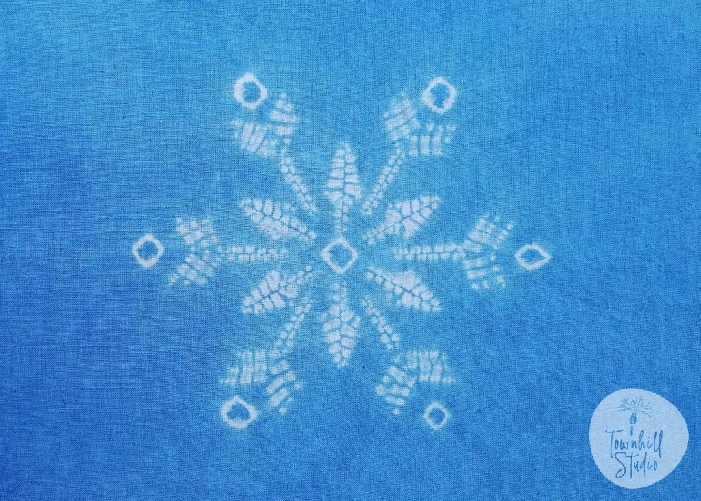 shibori snowflake design in blue and white