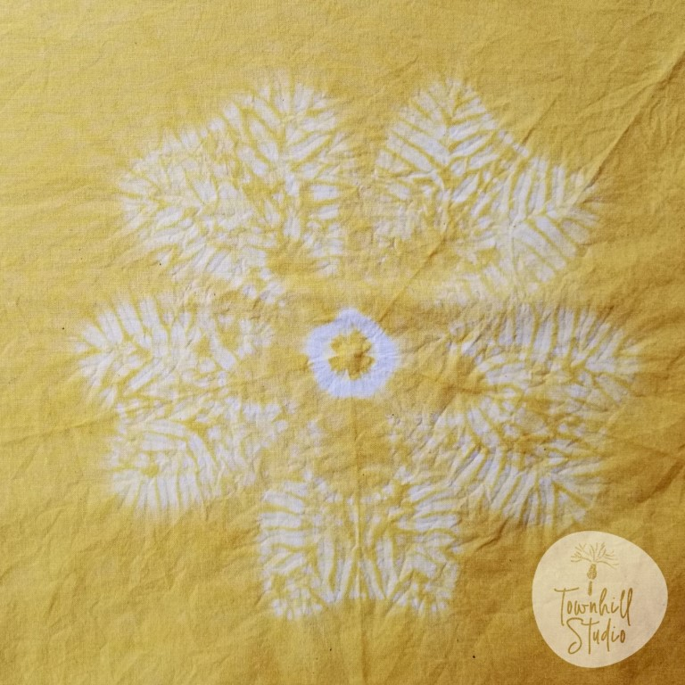 shibori stitch with yellow dye