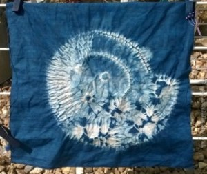 stitch resist shibori ammonite