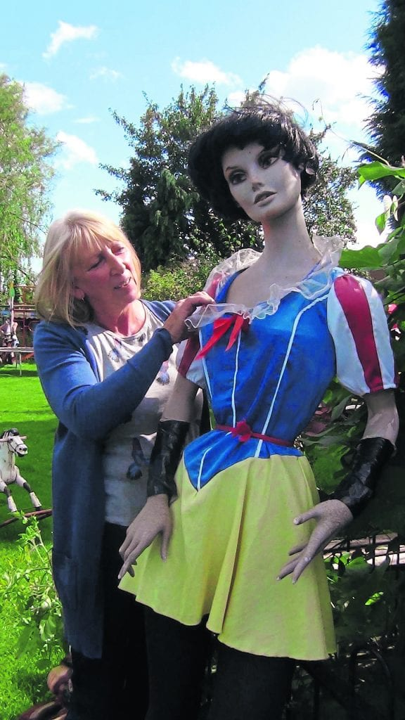 Elaine Gilbert adjusts the blouse on one of her mannequins