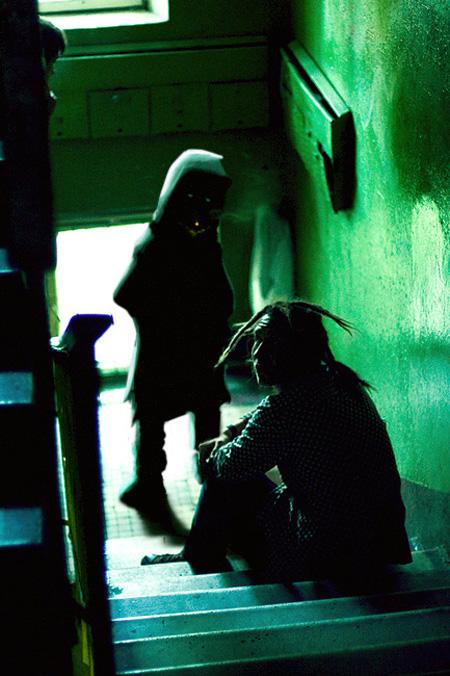 Demonic dealer on urban staircase - cyberpunk horror