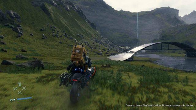 videojuego gameplay death stranding paisaje puente moto