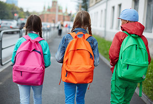 kids with backpacks - Copyright – Stock Photo / Register Mark