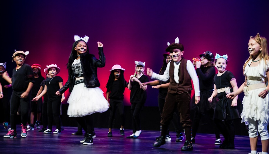 students performing artistocats