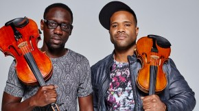 Kev Marcus and Wil B hold violins over their shoulders