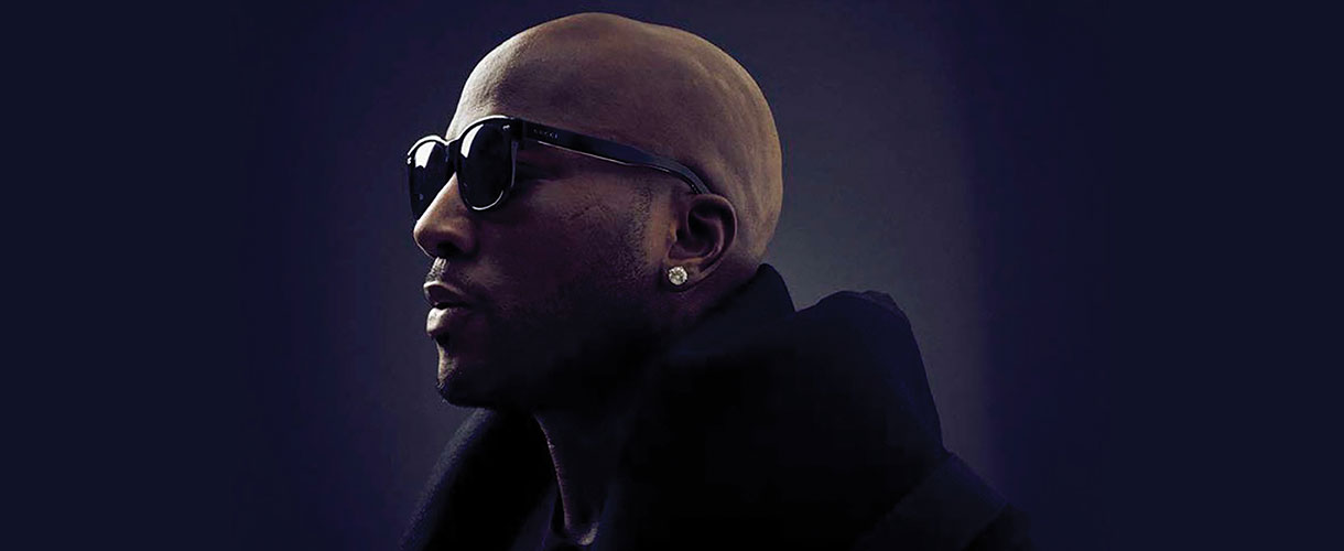 jeezy staring to the left with glasses and earring visible