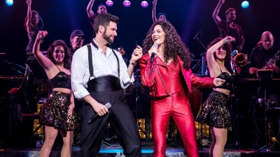 Mauricio Martinez as Emilio Estefan and Christie Prades as Gloria Estefan and company in 'On Your Feet!'
