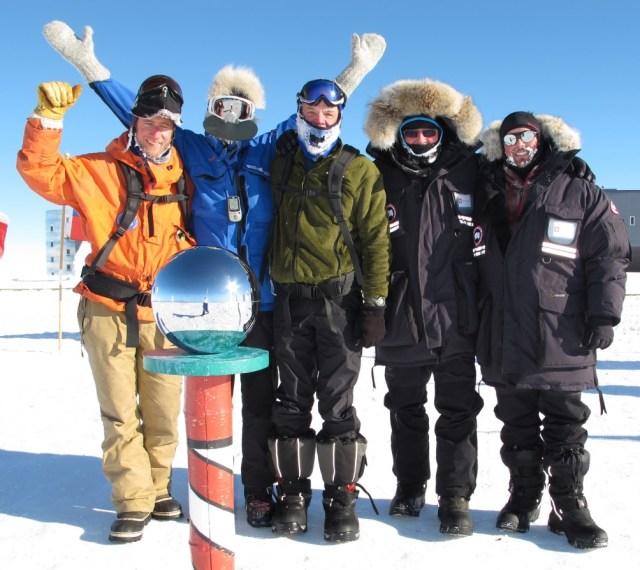 Team at ceremonial pole