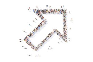 Photo of a arrow symbol pointing upwards made up of all professional people