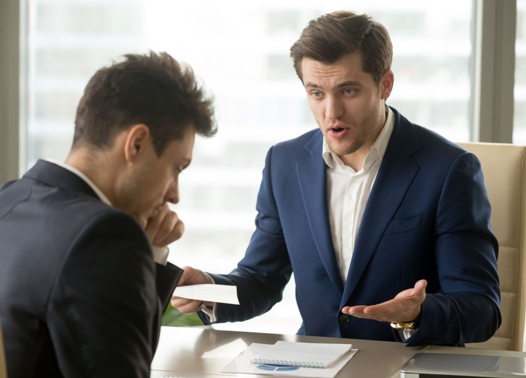 Picture of an employer interviewing a male applicant.