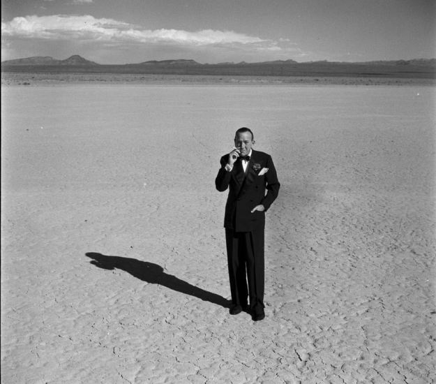 Coward as Ozymandias (with his head still on).  From a series of pictures taken for Life Magazine when Coward appeared at  the Desert Inn in Las Vegas.  The live recording of his act was a best-seller.