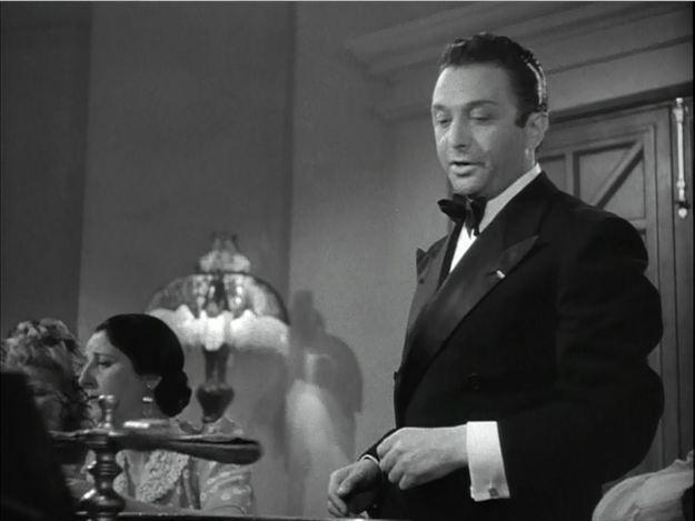 Marcel Dalio as Emil. Ellinor Vanderveer, queen of the dress extras, is beside him.