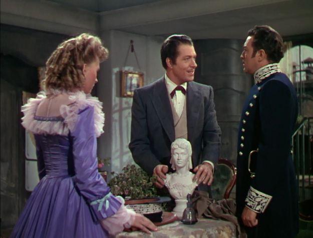 A triangle of squares: Susanna Foster, Nelson Eddy, Edgar Barrier. Eddy himself molded the little bust.