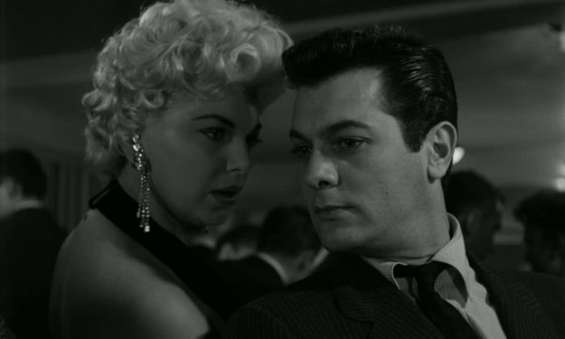 Barbara Nichols, Tony Curtis.  Rita: Are ya listenin'? Falco: Avidly, avidly.