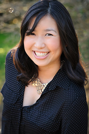 Picture of author Traci Chee looking up and smiling
