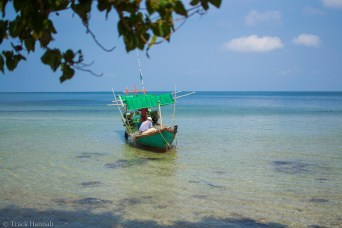 A fisherman from the only famiily living on this island is gathering the nets together with his son.