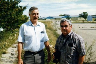 1997, John Armstrong (ret. Warrant Officer, Radar Tech, deceased) chatting with Leo Whyte (ret. Master Warrant Officer, Radar Tech) near the mess hall (barracks in background).