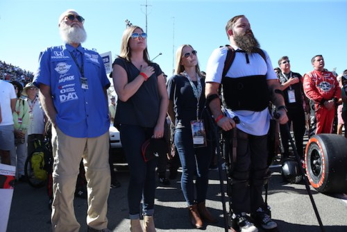 Paraplegic ARMY Sergeant Dan Rose stands for the National Anthem with Rahal Letterman Lanigan Racing co-owner David Letterman at the GoPro Grand Prix of Sonoma. ((Photo courtesy of Indianapolis Motor Speedway, LLC Photography)