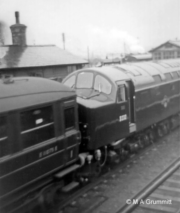 Much cleaner! The new order, in the shape of gleaming English Electric Type 4 (later Class 40) No. D232, passes northbound brand new on a trial run. These locomotives were not poular on the East Coast Main Line because of poor relibility. D232 spent nearly all its working life on the West Coast Main Line, carrying the name Empress of Canada after the Canadian Pacific liner which sailed regularly out of Liverpool. Photograph by Mick Grummitt