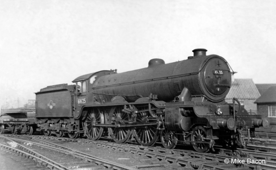 Class B17/1 No. 61625 Raby Castle is far from its home shed of Ipswich with a freight train at Grantham's Down side goods yard Photograph by Mike Bacon.