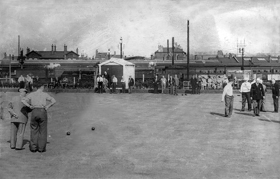 A game of bowls in progress with the locomotive yard and station beyond. Photograph from the Grantham Matters website.