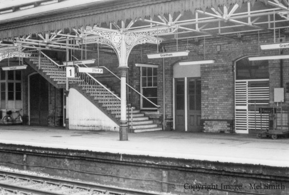"A wider view of the stairs from platform 1 leading to the foot bridge across to platform 2. Again the Battery Room & Lobby doors are central to the photograph. The doors to the right lead to the ""Cable Room"" and ""Telegraph Office"" Copyright Image - Mel Smith"