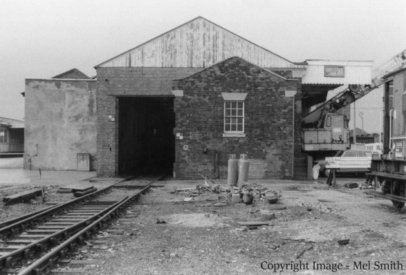The end of our short walk along Station Road. We turn around to face the Goods Shed and Office. The now demolished Yard Box was situated to the left of this vantage point. The mobile cranes in the previous view can be seen on the right. Copyright Image - Mel Smith