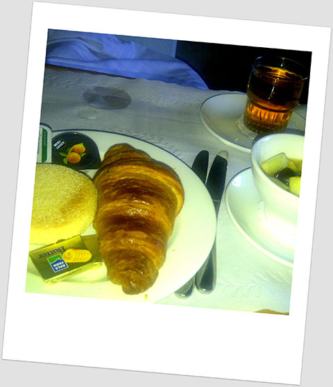Breakfast Day 21: A Croissant, A Muffin, A Bowl Of Fruit & A Glass Of Apple Juice