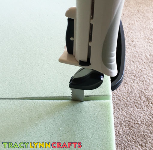 Using an electric knfe to cut memory foam mattress