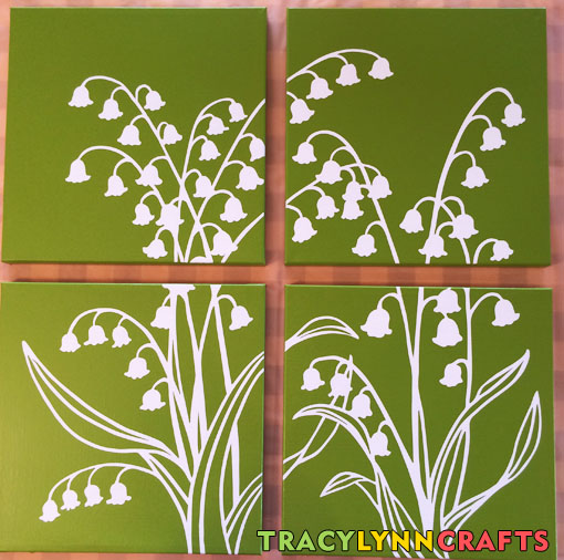 The stenciled lily of the valley design is now on all four of the canvas panels waiting to dry before hanging on the wall