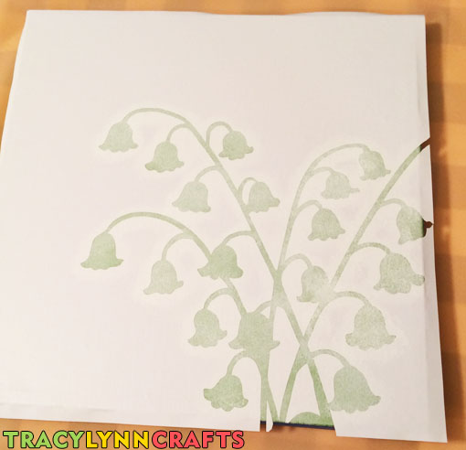 Second part of the lily of the valley stencil design applied to the next canvas panel