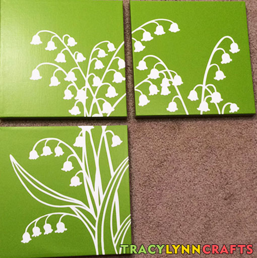 Stenciling on the third canvas panel is complete