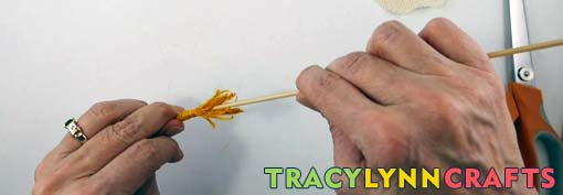 Insert the skewer into the base of the stamen