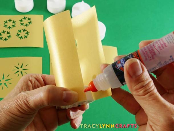 Glue along the long edge (do not glue to the tea light)
