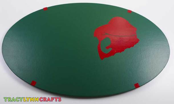 Apply the red layer by aligning the registration marks to the outer edge of the plaque