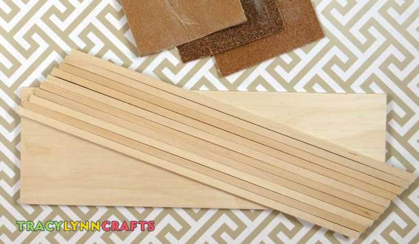 Lightly sand the wood pieces before assembling the chipboard winter scene baseboard