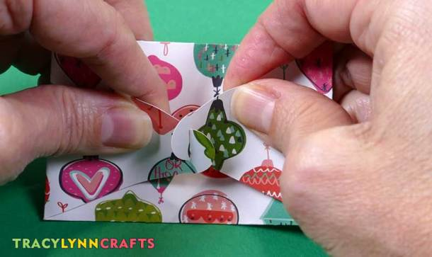 To close the envelope, slide the cuts that are in the curved ends into each other