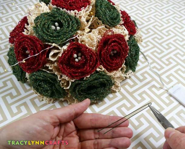 Make staples for attaching the LEDs by folding florist wire